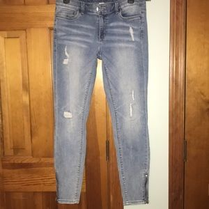 Skinny fit blue jeans size 4.